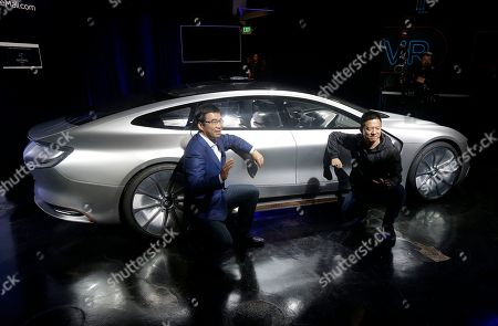 LeEco CEO Jia Yueting, right, and co-founder and SEE Plan Global Vice Chairman Lei Ding pose for photos after unveiling the LeSEE car at an event in San Francisco
