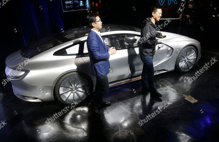 LeEco CEO Jia Yueting, right, and co-founder and SEE Plan Global Vice Chairman Lei Ding smile after unveiling the LeSEE car at an event in San Francisco