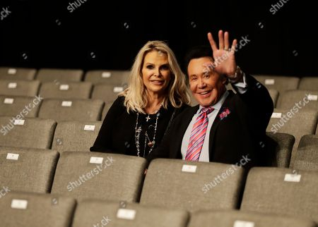 Entertainer Wayne Newton sits with his wife Kathleen McCrone before the third debate between Democratic presidential nominee Hillary Clinton and Republican presidential nominee Donald Trump during the third presidential at UNLV in Las Vegas
