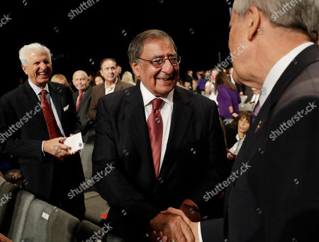 Former Secretary of Defense Leon Panetta, center, is greeted before the third debate between Democratic presidential nominee Hillary Clinton and Republican presidential nominee Donald Trump during the third presidential at UNLV in Las Vegas
