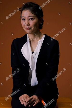 Stock Photo of Miwa Nishikawa In this picture taken, director Miwa Nishikawa poses for portraits for the film ' Nagai Iiwake' (Long excuses), at the 11th edition of the Rome Film Festival in Rome