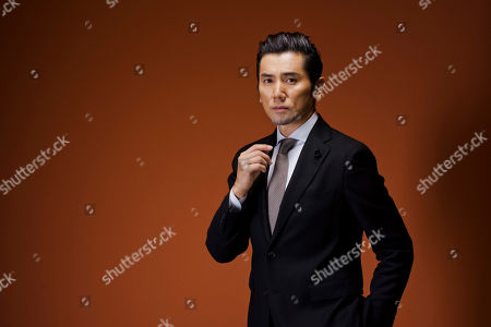 Stock Photo of Masahiro Motoki In this picture taken, actor Masahiro Motoki poses for portraits for the film ' Nagai Iiwake' (Long excuses), at the 11th edition of the Rome Film Festival in Rome