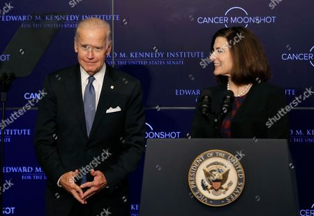 """Joe Biden, Vicki Kennedy Vice President Joe Biden reacts as he is introduced by Vicki Kennedy, widow of Sen. Edward Kennedy, for his speech at the Edward M. Kennedy Institute for the United States Senate, in Boston, about the White House's cancer """"moonshot"""" initiative ? a push to throw everything at finding a cure within five years"""
