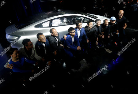 Stock Image of LeEco CEO Jia Yueting, fifth from right, and co-founder and SEE Plan Global Vice Chairman Lei Ding, sixth from right, pose for photos with others after unveiling the LeSEE car at an event in San Francisco