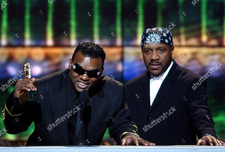"ISLEY BROS Musicians Ron Isley, left, and Ernie Isley, of The Isley Bros., accept The Michael Jackson Award for Best R&B/Soul or Rap Music Video for ""Contagious,"" at the 16th Annual Soul Train Music Awards in Los Angeles"