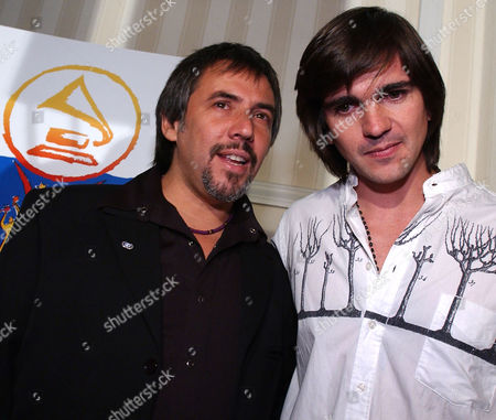 JUANES ALEJANDRO LERNER Colombian singer Juanes,right, hugs Argentinian singer/songwriter Alejandro Lerner after announcing the nominations for the 3rd Annual Latin Grammy Awards in Beverly Hills, Calif., . Juanes was nominated for three awards and Lerner for one. The Awards will be presented at the Kodak Theatre in Hollywood Sept. 18, 2002