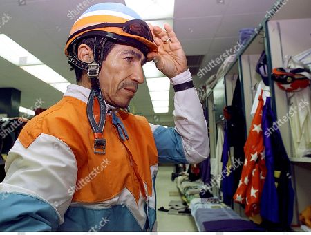 LAFFIT PINCAY JR Jockey Laffit Pincay Jr. adjusts his helmet, before a race at Hollywood Park in Inglewood, Calif. After nearly 48,000 races and more than 50,000 miles, about twice around the Earth, in the saddle, he is the winningest jockey of all time. The seemingly ageless Pincay is 55, and he is riding as well or better than ever as he climbs nearer the 10,000-win plateau