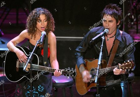 MYA CUEVAS Pop singer Mya, left, sings a duet with Alberto Cuevas of the Chilean group La Ley during the 2002 ALMA Awards at the Shrine Auditorium in Los Angeles, Calif., . The annual awards show celebrates Latino honors in film, television and music
