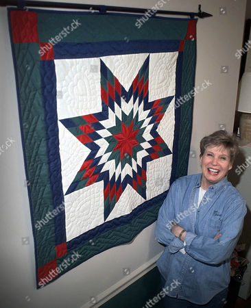 "Stock Photo of ANDERSON ADVANCE FOR SUNDAY APRIL 28 ** Becky Anderson, Executive director of Handmade In America, stands beside a handmade ""Mountain Star"" quilt inside her Asheville, N.C. office, . Anderson is helping sponsor a conference Monday and Tuesday, entitled ""Building Creative Economies: The Arts, Entrepreneurship and Sustainable Development in Appalachia"" that is expected to draw people from 30 states to the Asheville area to talk about how to build an economy around the heritage and culture of a region. State delegations will include artists, cultural specialists, buisness people, and government leaders"