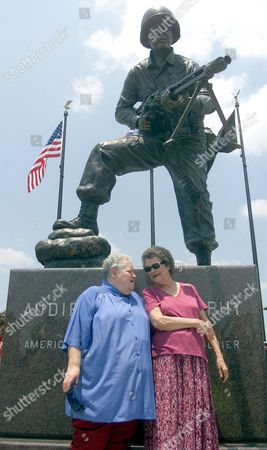 Stock Photo of MURPHY LOKEY Billie Murphy, left, and Nadene Lokey, right, stand in front of a statue of their brother, World War II hero and movie star Audie Murphy, after an unveiling of the statue in Greenville, Texas. Greenville sculptor Gordon Thomas created the image of Murphy in combat, perched on top of a 5-foot-high granite base. The sculpture along Interstate 30 is near the Audie Murphy/American Cotton Museum in Greenville, one of several area towns to claim Murphy as a hometown hero