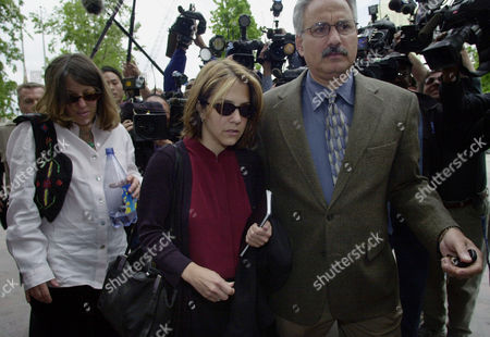 BLAKE Delinah Blake, center, daughter of actor Robert Blake, arrives for her father's hearing at Los Angeles Superior Court with Scott Ross, a private investigator working for Robert Blake's attorney Harland Braun, . At left is Robert Blake's niece, Noreen Austin. Robert Blake was jailed without bail on April 18 on charges of murder, solicitation of murder, conspiracy and the special circumstance of lying in wait. His bodyguard, Earle Caldwell, 46, was arrested on the conspiracy count and was released on $1 million bail posted by Blake