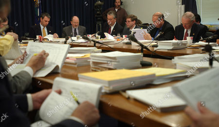 BUDGET Members of Kentucky's House and Senate thumb through piles of budget papers in hopes to iron out their differences in Frankfort, Ky. In back left to right: Sen. Richie Sanders, R-Franklin, Jerry Bailey, chief budget staffer for the legislature, Sen. David Williams, R-Burkesville, Sen. Dan Kelly, R-Springfiled, Sen. Charlie Borders, R- Russell and Sen. Dick Roeding, R-Lakeside Park