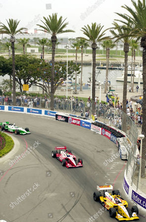 VASSER BRACK TRACY Jimmy Vasser, right, Kenny Brack of Sweden, middle, and Paul Tracy, of Canada, left, head through a series of corners with the Queen Mary in the background, in Long Beach, Calif. Vasser finished second, Brack fourth and Tracy seventh in the Toyota Grand Prix of Long Beach