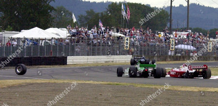 BRACK Kenny Brack, far right, loses his left rear wheel, left, and the lead in the CART G.I. Joe's 200 in Portland, Ore., . Cristiano da Matta won his third race of the young CART season