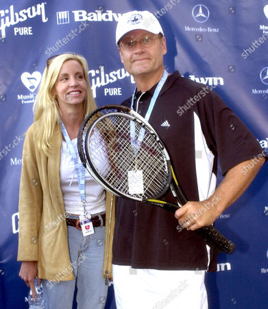 DONATACCI GRAMMER Actor Kelsey Grammer, right, arrives with his wife, Camille Donatacci, for his charity tennis match to kick off the Mercedes-Benz Cup tennis tournament, in Los Angeles. Grammer played against television show host Dr. Phil McGraw, which benfits the MusiCares Foundation