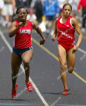 Stock Photo of OWENS REAUX Liberty's Ashley Owens, left, edges out Pueblo Centennial's Dominique Reaux for the state title in the girls Class 4A 100 meters during the state track and field championships at Jefferson County Stadium in Lakewood, Colo