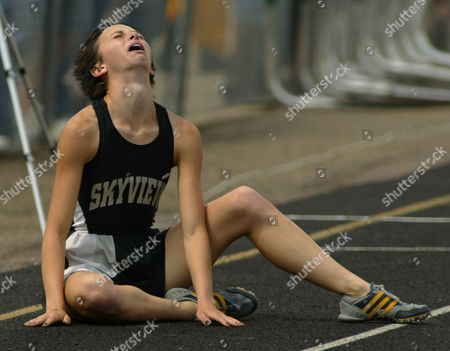 MOORE Skyview's Christine Moore sits on the track after losing the 300-meter hurdles during the Class 4A track and field championships at Jefferson County Stadium in Lakewood, Colo