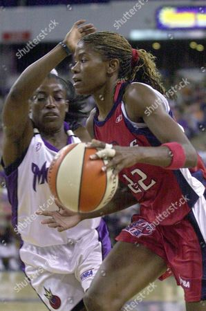 Stock Image of BOLTON SWOOPS Houston Comets forward Sheryl Swoops, right, drives to the basket against Sacramento Monarchs guard Ruthie Bolton during the second half at Arco Arena in Sacramento, Calif., . Swoopes scored 15 points to lead the Comets to a 74-60 victory over the Monarchs