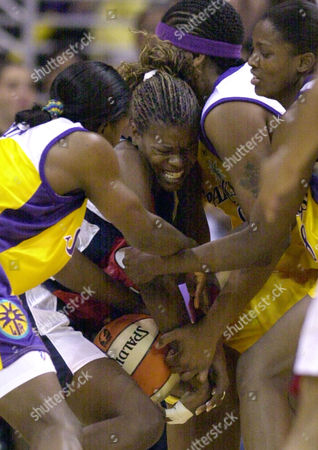 Stock Picture of MILTON Houston Comets' Sheryl Swoops, center, battles for the ball under heavy coverage from Los Angeles Sparks' Mwadi Mabika, left, Latasha Byears, second from right, and DeLisha Milton, right, during the second half, in Los Angeles. The Comets won, 60-58