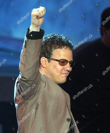 SAMS EDS NOTE: REPEATS TO CORRECT CAPTION TO CLARIFY DEAN SAMS IS MEMBER OF THE GROUP LONESTAR, NOT TRICK PONY ** Dean Sams, of the group Lonestar, gestures after accepting the group's award for top vocal group during the 37th Annual Academy of Country Music Awards, in Los Angeles
