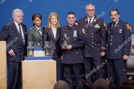 DEWAN Posing with the speical Profile in Courage Award for Public Service are, from left, U.S. Senator Ted Kennedy, D-Mass., U.S. Army Lt. Colonel Marilyn Wills, Caroline Kennedy, NYPD Officer Michael Gerbasi, FDNY Chief Brian O'Flaherty and Brooklin, Mass., fireman John Dewan, at the John F. Kennedy Library in Boston. The special award was accepted on behalf of the thousands of public servants who demonstrated extraordinary courage and heroism in response to the Sept. 11 terrorist attacks