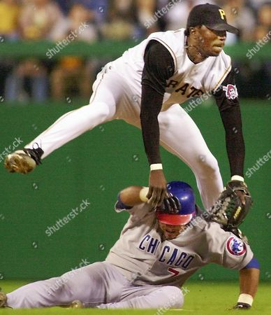 MACHADO REESE Chicago Cubs' Robert Machado, bottom, takes Pittsburgh Pirates second baseman Pokey Reese out of the double play on teammate Darren Lewis in the eighth inning in Pittsburgh