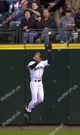 ICHIRO SUZUKI Seattle Mariners right fielder Ichiro Suzuki jumps to snag a fly ball off the bat of Tampa Bay Devil Rays' Greg Vaughn in the second inning, in Seattle. Vaughn was out on the play