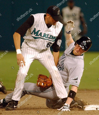 FOX, HUFF Florida Marlins shortstop Andy Fox (6) tags out Tampa Bay Devil Rays' Aubrey Huff, right, who was trying to stretch a single into a double in the ninth inning, in Miami. Greg Vaughn scored on the play