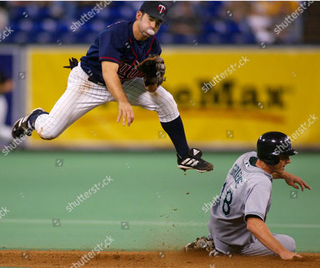 CANIZARO GRIEVE VAUGHN Minnesota Twins second baseman Jay Canizaro jumps over Tampa Bay Devil Rays' Ben Grieve after forcing Grieve out at second base on an attempted double play in the sixth inning, in Minneapolis. Devil Rays' Greg Vaughn was safe at first base