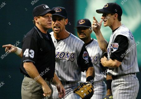 COUNSELL Third base umpire Paul Schrieber, left, listens to the argument of Arizona Diamondbacks' Luis Gonzalez, Tony Womack, and Craig Counsell, left to right, in the eighth inning, at Jacobs Field in Cleveland. Schrieber called a ball hit by Cleveland Indians' Bill Selby fair. The Diamondbacks won 4-2