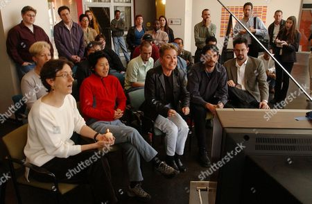ANDERSON A group of people including Bonnie Anderson, center with clenched fists, reacts at the San Francisco Lesbian Gay Bisexual Transgender Community Center, as it watches reports on television of guilty verdicts being read on all counts in the fatal dog mauling trial taking place in a Los Angeles courtroom. The victim, Diane Whipple, was a lesbian from San Francisco