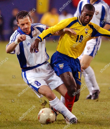MENDEZ MIJATOVIC Ecuador midfielder Edison Mendez (19) and Yugoslavia's Predrag Mijatovic (8) battle for control of the ball during the first half of friendly match Wednesday night, at Giants Stadium in East Rutherford, N.J