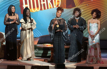 BASSETT Author Terry McMillan, center, is joined onstage by actresses who have performed in films based on her books, as she holds the Excellence in Literature award during the 2002 Essence Awards at the Universal Amphitheater in Universal City, Calif., . From left behind McMillan are actresses Lela Rochon Fuqua, Phyllis Yvonne Stickney, Loretta Devine and Angela Bassett
