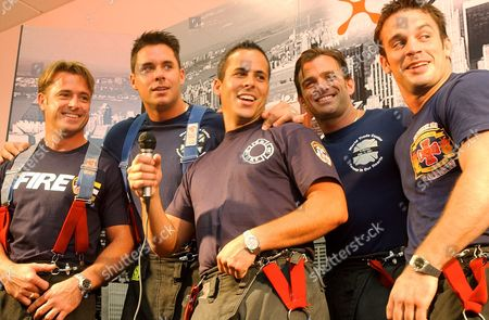 """Stock Photo of PAVIS New York firefighters-models, from left, Mr. February Ed McNulty, Mr. December Matthew Mills, Mr. April Mike Burke, Mr. September Ritch Eckert, and Mr. June Rob Pavis, sing a karaoke version of """"New York, New York"""" while they promote their 2003 Calendar of Heroes, in New York. A portion of the profits from the sale of the beefcake-style calendar will be donated to the FDNY Fire Safety Education Fund and is dedicated to the 343 firefighters who lost their lives in the Sept. 11, 2001terrorist attacks"""