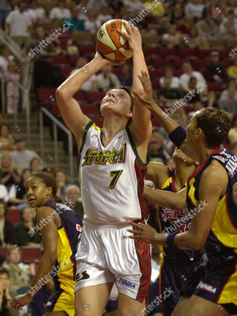 CATCHINGS Seattle Storm's Kamila Vodichkova shoots between Indiana Fever's Tamika Catchings, left, Alicia Thompson, partially hidden, and Olympia Scott-Richardson, right, during the first half, in Seattle