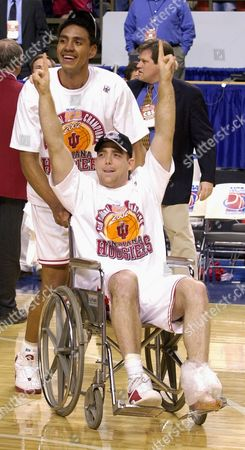 COVERDALE, JEFFRIES Indiana's Tom Coverdale gestures from a wheelchair pushed by teammate Jared Jeffries after Indiana beat Kent State 81-69 in the NCAA South Regional championship game at Rupp Arena in Lexington, Ky. . Now that Indiana has advanced to its first Final Four since 1992, the Hoosiers made it clear Monday that they are expanding their horizons and adjusting their goals