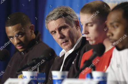 Maryland's Juan Dixon, left, coach Gary Williams, second from left, and Steve Blake listen to Chris Wilcox, right, during a news conference in Atlanta. Indiana will face Maryland Monday in the NCAA final