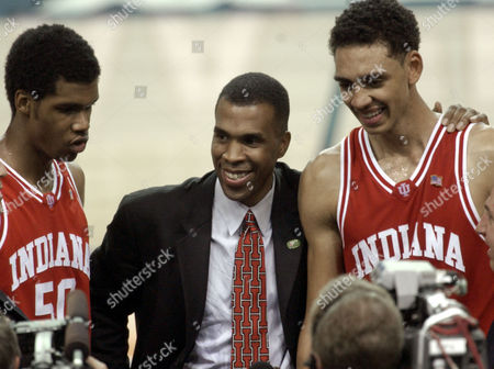 DAVIS Indiana head coach Mike Davis, center, celebrates his 73-64 win over Oklahoma in the semifinals of the Final Four with players Jeff Newton (50) and Jared Jeffries (1) right, in the Georgia Dome in Atlanta