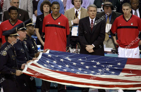 WILLIAMS Maryland guard Juan Dixon, second from right and guard Steve Blake, right, flank head coach Gary Williams as Atlanta police officers carry a flag from the World Trade Center onto the court for the National Anthem before the start of the NCAA championship game between Maryland and Indiana in the Georgia Dome in Atlanta