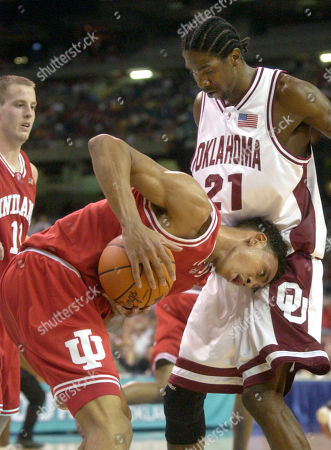 JEFFRIES BROWN FIFE Indiana's Jared Jeffries (center) bumps into Oklahoma's Jabahri Brown (21) as Indiana's Dane Fife (11) looks on during second half action in the NCAA semifinal in Atlanta
