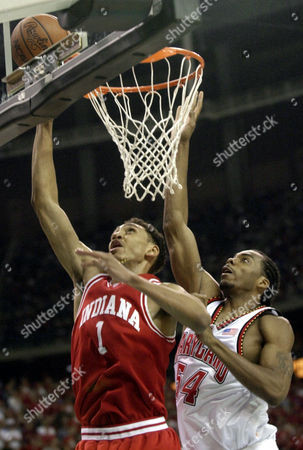 Stock Photo of JEFFRIES WILCOX Indiana foward Jared Jeffries (1) goes to the basket over Maryland's Chris Wilcox (54) during second half play in the NCAA championship game in the Georgia Dome in Atlanta