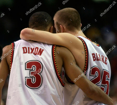 Maryland's Juan Dixon, (3) and Steve Blake embrace after defeating Kansas 97-88 in an NCAA semifinal in Atlanta