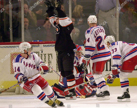 FLEURY Philadelphia Flyers' Simon Gagne, center, celebrates a second period goal by teammate Eric Desjardins against New York Rangers goaltender Dan Blackburn in New York. Defending for the Rangers are Theo Fleury (14), Sylvain Lefebvre (24) and Dave Karpa (33