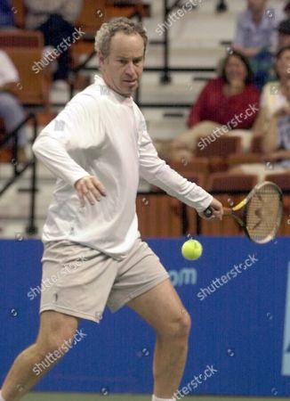 MCENROE John McEnroe of the New York Hamptons gets set to make a forehand return to Murphy Jensen of the Hartford FoxForce in a Word Team Tennis match in Uncasville, Conn., . Murphy defeated McEnroe