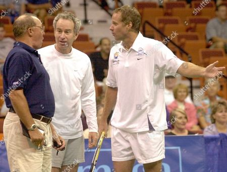 ROSNER MCENROE John McEnroe, center, and his brother Patrick, right, of the New York Hamptons discuss a line call with chair umpire Bob Rosner, left, during their World Team Tennis men's doubles match with Luke and Murphy Jensen of the Hartford FoxForce, in Uncasville, Conn