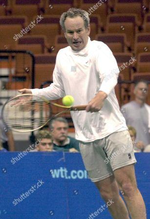 MCENROE John McEnroe of the New York Hamptons returns a backhand to Murphy Jensen of the Hartford FoxForce during their World Team Tennis singles match in Uncasville, Conn., . Jensen defeated McEnroe