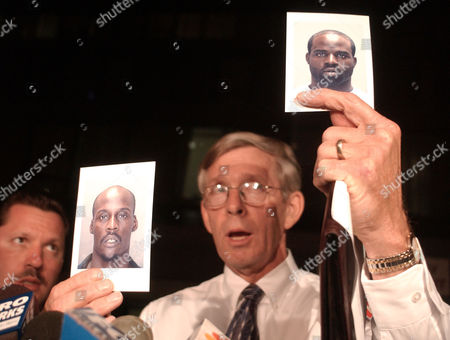 DAVIS Philadelphia Police Chief Inspector Robert Davis holds up photographs of James Burns, left, and Edward Johnson, right, at a news conference outside of Children's Hospital of Philadelphia in Philadelphia. Erica Pratt, 7, who witnesses had said was grabbed, kicking and screaming, from in front of her home was found nearly 24 hours later and appeared to be unharmed, police said. Police said that Burns, 29, and Johnson, 23, are considered suspects in the abduction