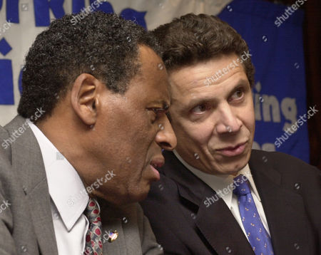 MCCALL CUOMO New York Democratic gubernatorial contenders H. Carl McCall, left, and Andrew Cuomo talk among themselves during a joint appearance calling on Gov. George Pataki to increase the state's minimum wage by more than a dollar an hour, in New York