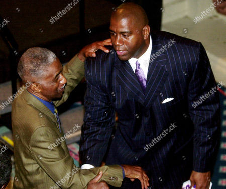 "JOHNSON HAYNES Earvin ""Magic"" Johnson, right, exchanges greetings with Hall of Famer Marques Haynes, who retired from the Harlem Globetrotters, at the Naismith Basketball Hall of Fame luncheon, in Los Angeles. The Hall's Class of 2002 including Johnson, the Harlem Globetrotters, coaches Larry Brown, Lute Olson, and Kay Yow and the late Drazen Petrovic"