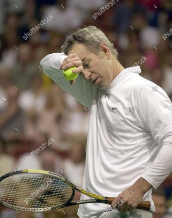 MCENROE New York Hamptons' John McEnroe wipes his face during his World Team Tennis singles match against Hartford Fox Force's Murphy Jensen, in Uncasville, Conn. Jensen defeated McEnroe